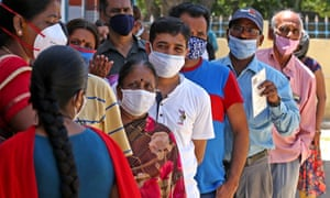 People stand in a queue to be vaccinated in Bangalore, India.