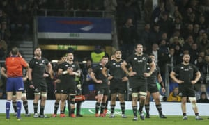 New Zealand's players watch the TMO review of Sam Underhill's 'try', which was eventually disallowed on a marginal offside call against Courtney Lawes.
