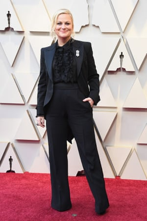 Amy Poehler wore a black Alberta Ferretti tuxedo, replete with tails and a sheer ruffle blouse – prompting a flurry of Twitter proposals (and a few Leslie Knope comparisons) as she was joined on the red carpet by pals Tina Fey and Maya Rudolph.