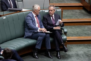 The Nationals whip Damien Drum talks to Bill Shorten before question time