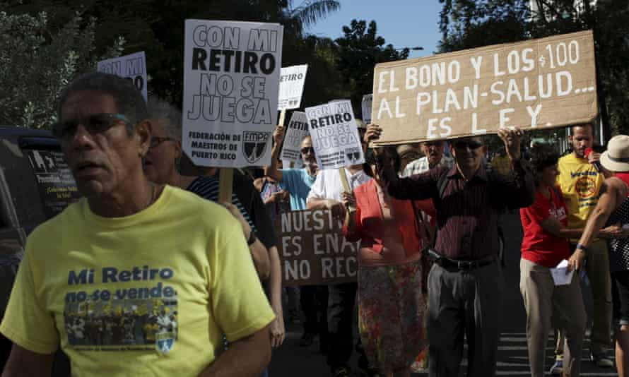 Retired Puerto Rican teachers protest with signs: 'Don't play with my retirement.'