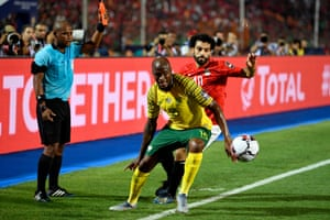 Egypt's forward Mohamed Salah (right) tussles with South Africa's defender Sifiso Hlanti.