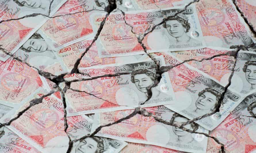 Cracked fifty pound notes concept to represent an economic crisis