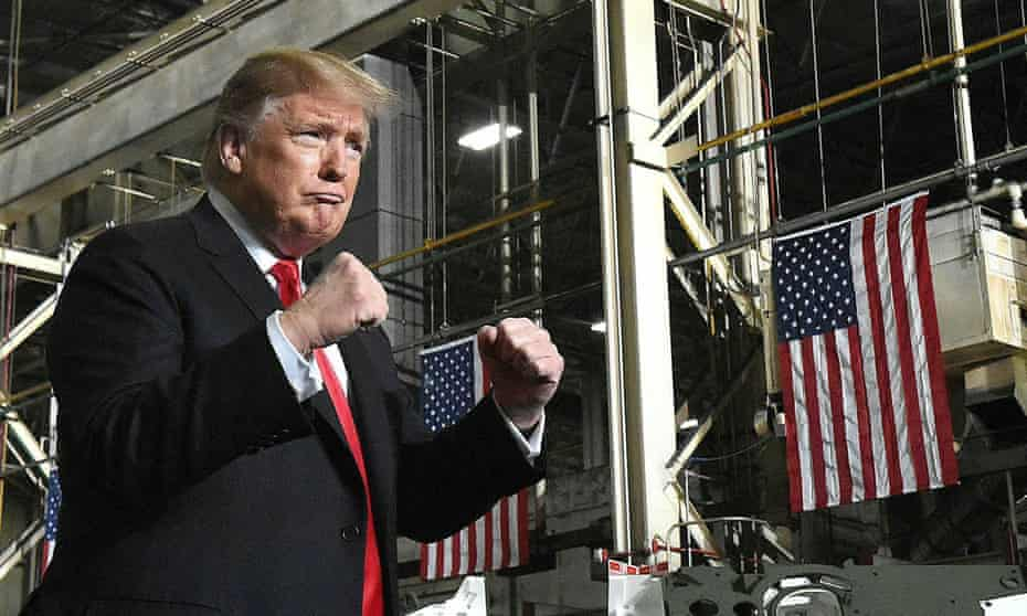 Donald Trump makes two fists while making a public appearance.