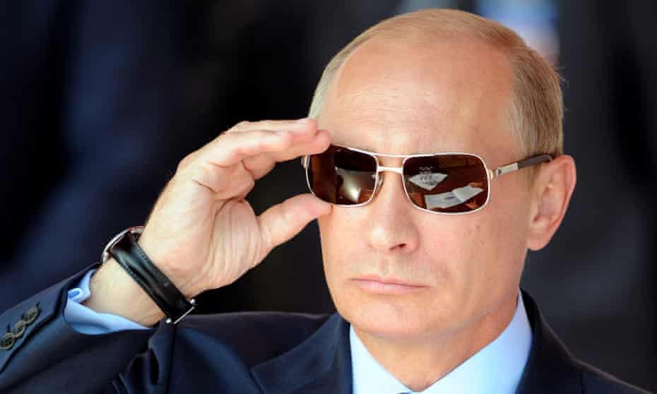 Russian prime minister Vladimir Putin adjusting his sunglasses