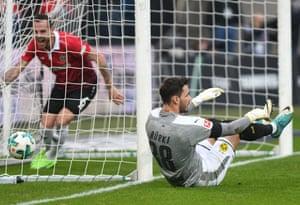 Dortmund's Roman Bürki is left on the ground as Marvin Bakalorz starts the celebrations for Hannover.