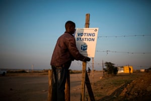 A local resident hangs a sign in the Juju valley – an informal settlement of EFF voters – on the outskirts of the northern city of Polokwane