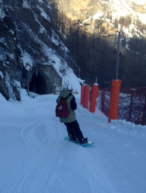 Snowboarder coasts down the mountain