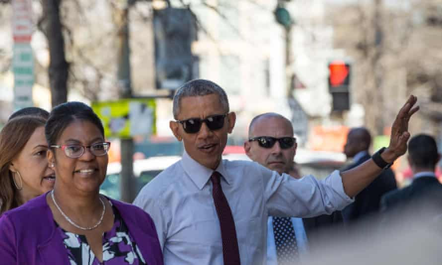 Barack Obama escorts Ramon Brant to the Busboys and Poets restaurant in Washington DC on 30 March 2016.