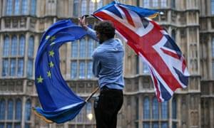 man waving UK and EU flag