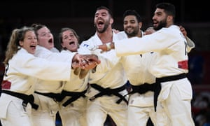 Team Israel celebrates winning the judo mixed team's bronze medal B bout against Russia.