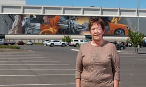 Homelessness worker Tracy Ingram stands in front of a car industry mural on an Elizabeth shopping centre