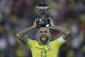 Dani Alves celebrates with his Copa América player of the tournament award.