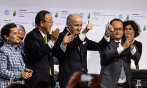 World leaders celebrate at the conclusion of the Paris conference.