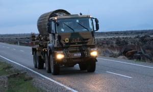 A Turkish military vehicle heads towards Syria's Afrin region.