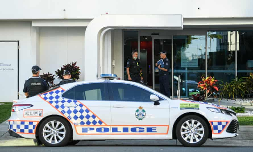Queensland police officers outside an apartment building in Labrador, a coastal suburb of the Gold Coast, Queensland, where a man and woman were found dead in a suspected murder-suicide