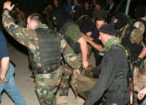 Georgian special police servicemen detain a man suspected of throwing a grenade during a speech by George W Bush.
