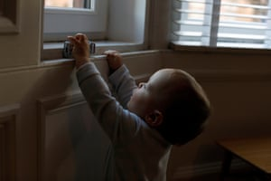 Aven drives a toy car over the windowsill.