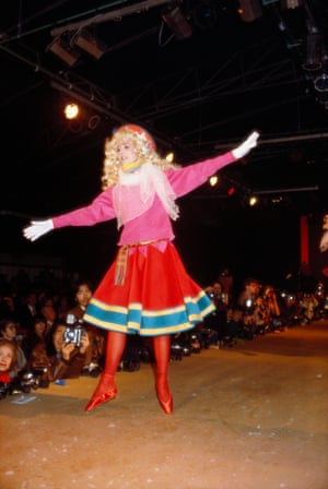 A model dances on the catwalk – Kenzo shows were famously fun and unorthodox – wearing a full skirt, beret and ballet slippers