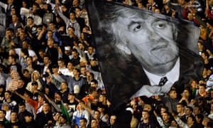Nationalist football fans wave a picture of Radovan Karadzic at match a in Belgrade, July 2008.