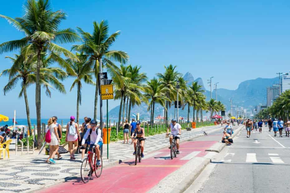 Cyclists in the bike lane next to the Ipanema Beach, Rio