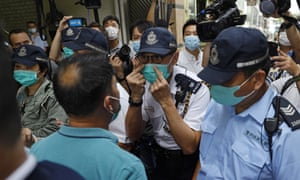 Police confront members of the Democratic party during a recent protest in Hong Kong.