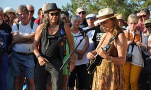 Gerard George Kettel and Claudia Rucker perform for fans at the inauguration of the Cohen bench on the Greek island of Hydra