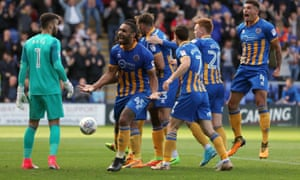 Shrewsbury Town's Aristote Nsiala celebrates with his teammates after scoring a goal to make it 1-0 against Blackburn