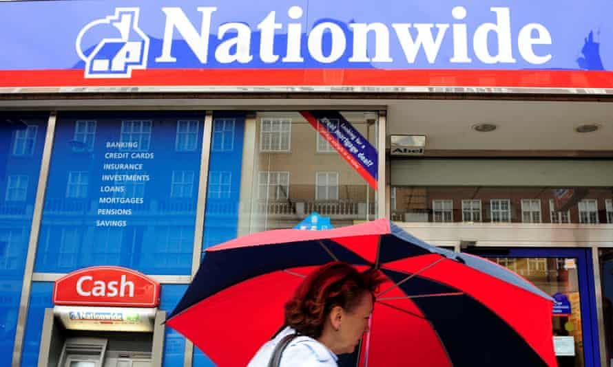 A woman passes a branch of the Nationwide building society