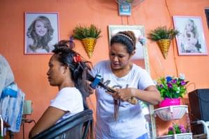 Manuela Dos Santos in her hairdressing shop in Dili