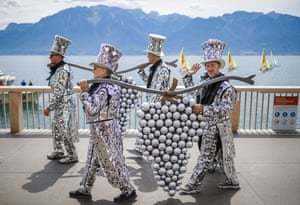 Participants march during the official opening parade through Vevey by Lake Geneva