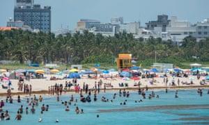 Beachgoers enjoy the warm weather in Florida on Wednesday.