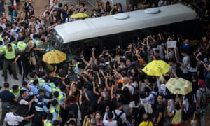 Supporters and media surround a bus, believed to have been carrying Joshua Wong, outside the high court in Hong Kong