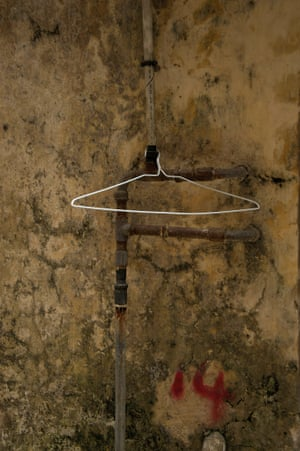 Hong Kong White coat hanger A worker's outdoor wardrobe, the fragility of the hanger wire, the robust old pipes, set into the canvas of the damp plaster walls of lost streets. A story and a reason exist, unknown to us. I love pondering what might have been or what will become of this hanger. Will it ever support a piece of clothing or does it have an entirely different purpose.