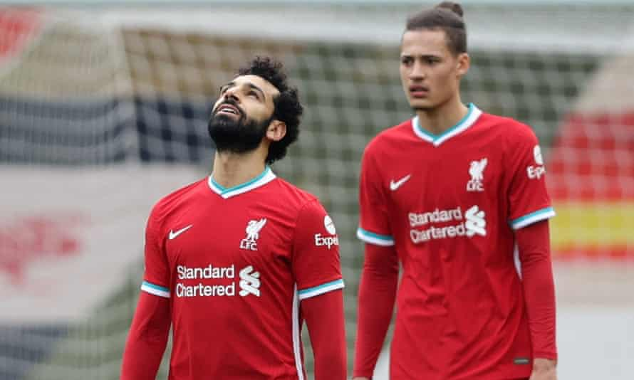 Liverpool's Mohamed Salah and Rhys Williams react after Fulham's Mario Lemina scored at Anfield