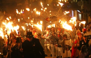 People carrying torches march during the traditional bonfire celebrations in Lewes
