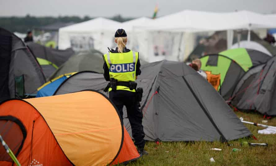 A police offer at Bravalla festiva in Sweden, where five women reported having been raped.