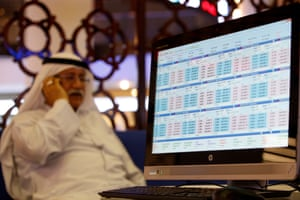 A trader following the stock market at the Dubai Financial Market, in the Gulf emirate of Dubai, United Arab Emirates.