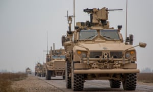 A convoy of US-led international coalition troops in the Deir ez-Zor province, Syria.