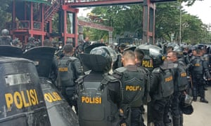 Indonesian riot police at a university in Jayapura on Monday.