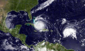 A satellite image shows Hurricane Irma, center, in the Caribbean Sea, Hurricane Jose, right, in the Atlantic Ocean, and Hurricane Katia in the Gulf of Mexico.
