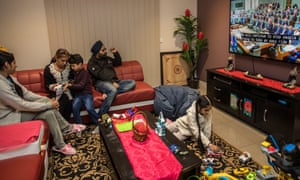 The Singh family watch Scott Morrison's budget speech on Tuesday night at their home in Epping