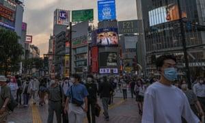 Pedestrians in central Tokyo on Friday.