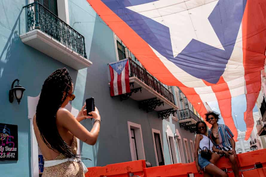 Tourists take pictures in front of the governor's mansion in San Juan, Puerto Rico.
