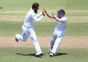 Moeen Ali and James Taylor (r) celebrate AB de Villiers wicket.