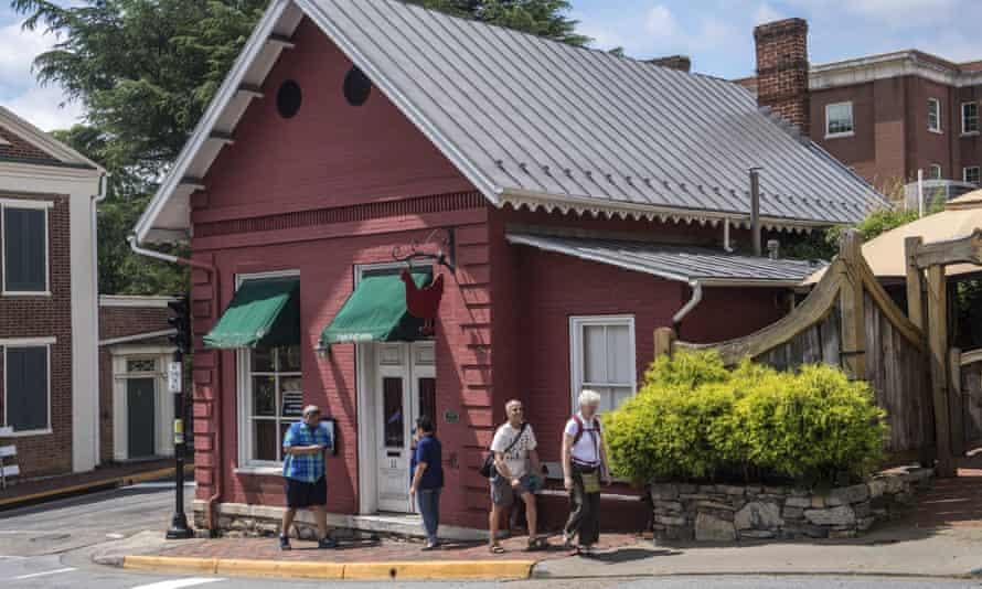 People walk past the Red Hen restaurant in Lexington, Virginia Wednesday.