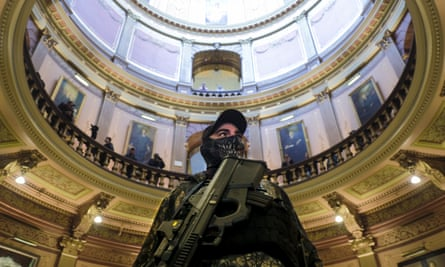 An armed protester at the Michigan Capitol Building in Lansing, 30 April 2020. Protesters demanded that the state not extend Governor Gretchen Whitmer's stay-at-home order.