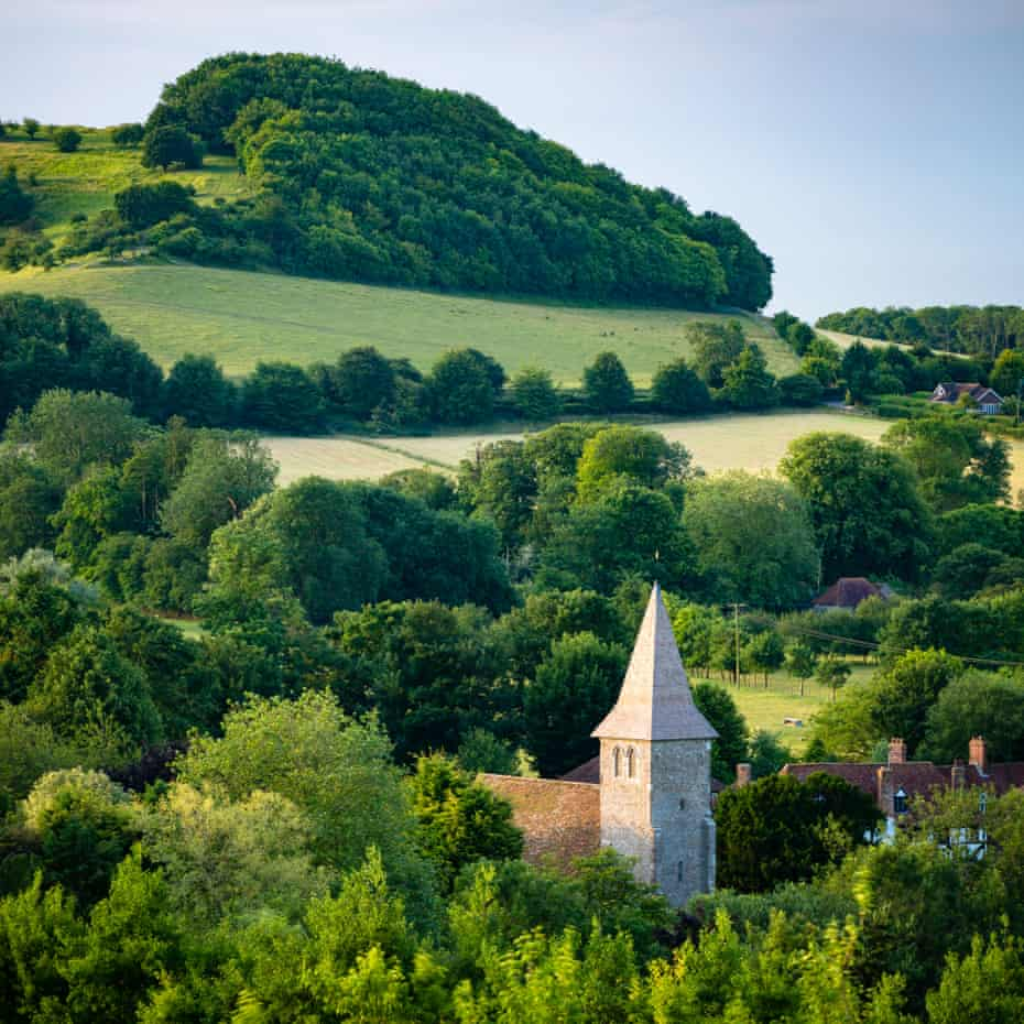 The village and Church of Postling, Kent. A notable view from the North Downs Way and Folkestone Downs.