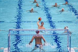 Montenegro's Dusan Matkovic scores a penalty throw against Serbia during the preliminary round of the men's water polo.