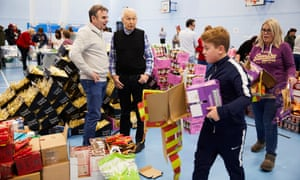Frank Field, centre, with volunteers filling Christmas hampers for Birkenhead's needy.